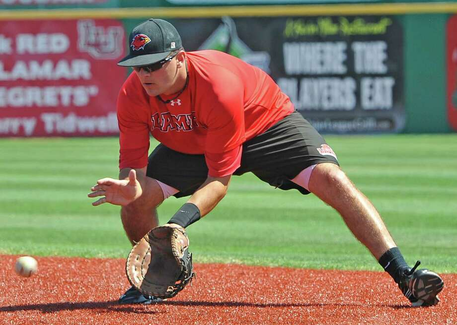 First baseman Seth Dornak takes some ground balls during batting practice during the Lamar University baseball team's practice Monday afternoon April 23, 2012. Dave Ryan/The Enterprise Photo: Dave Ryan