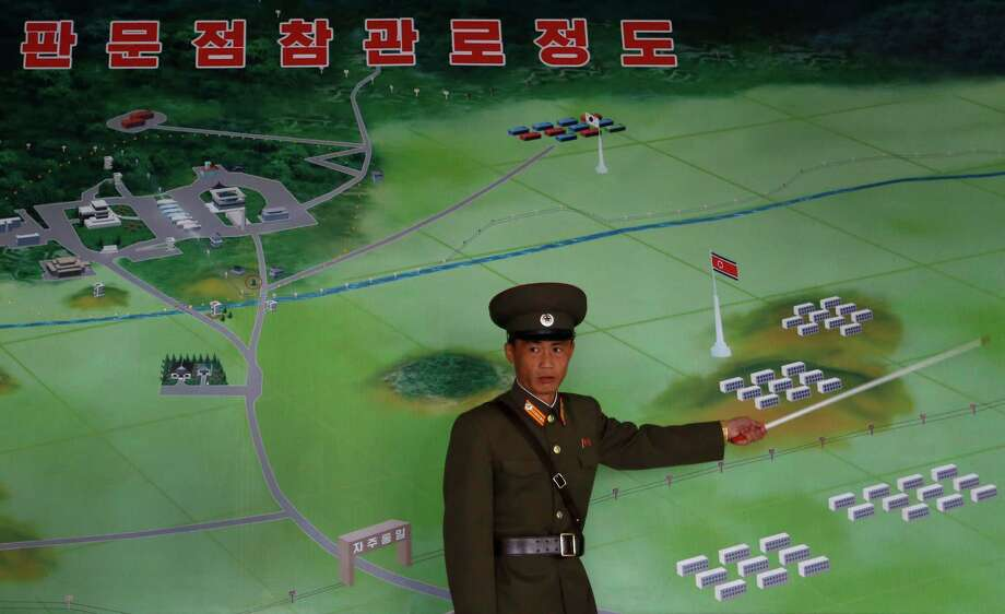 A North Korean military officer explains a diagram of the Demilitarized Zone that separates the two Koreas while speaking Monday in Panmunjom. Photo: Vincent Yu, Associated Press