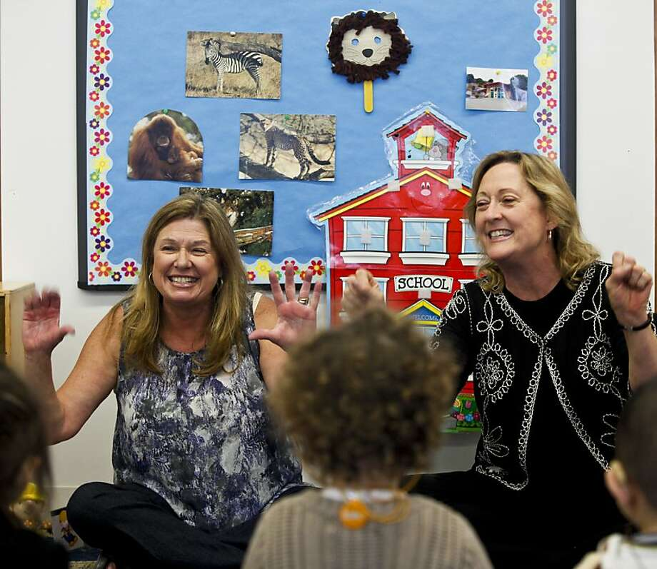 Linda Kelly-Lynch, left, and her sister, Kerry Hansell, work with children for the San Mateo County Office of Education's Early Start Program on Monday, April16, 2012 in San Mateo, Calif.  Kelly-Lynch teaches blind and visually impaired children while Hansell teaches deaf and hard of hearing kids. Photo: Russell Yip, The Chronicle