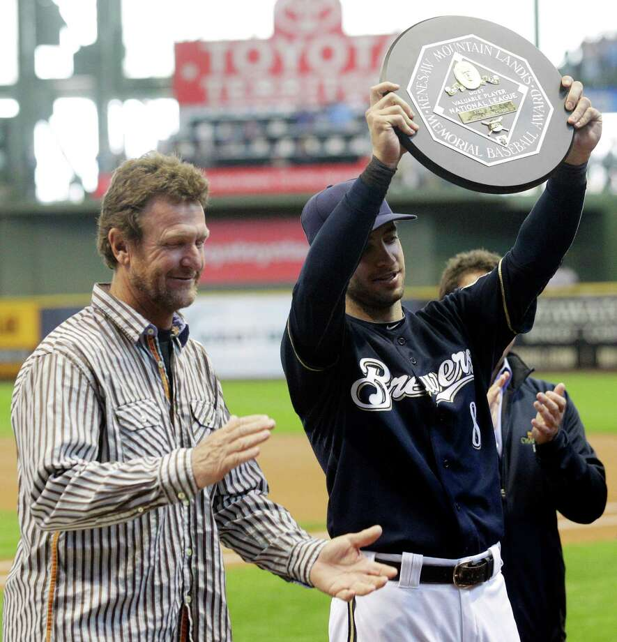 Milwaukee Brewers' Ryan Braun poses with his MVP trophy and Brewers Hall-of-Famer Robin Yount, left, before a baseball game against the Colorado Rockies, Sunday, April 22, 2012, in Milwaukee. Photo: AP