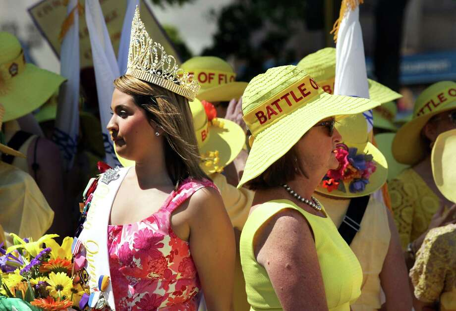 The 2012 Charro Queen Kellie Ramos, left, walks past members of the Battle of Flowers Association at The 87th Annual Pilgrimage to The Alamo, Monday, April 23, 2012. Photo: BOB OWEN, San Antonio Express-News / © 2012 San Antonio Express-News