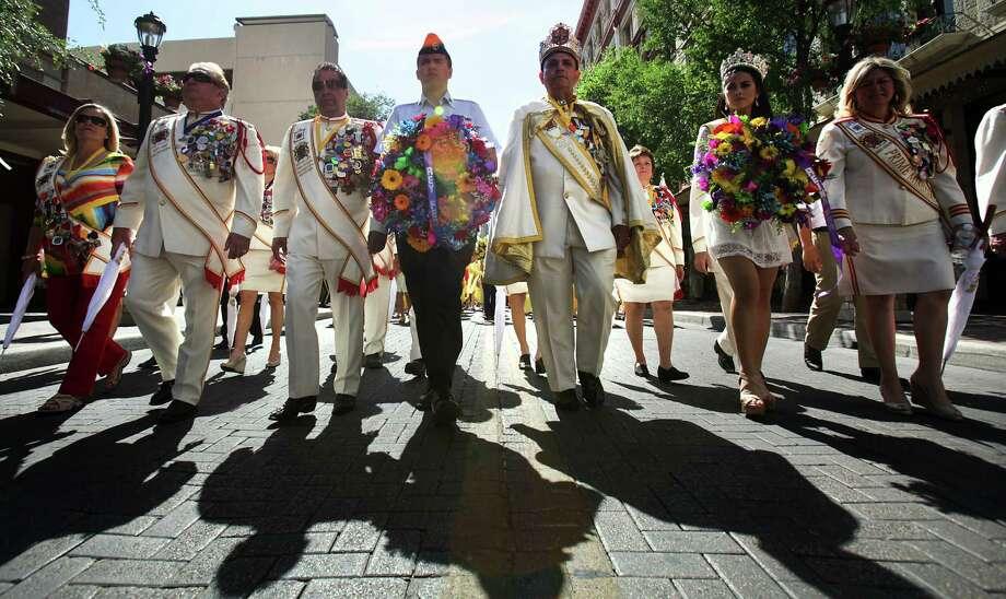 Rey Feo LXIV Richard Ojeda, third form right, marches with his entourage on Houston St. during the 87th Annual Pilgrimage to The Alamo, Monday, April 23, 2012. Photo: BOB OWEN, San Antonio Express-News / © 2012 San Antonio Express-News