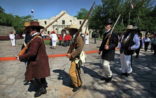 Alamo period reinactors march in front of The Alamo during the 87th Annual Pilgrimage to The Alamo, Monday, April 23, 2012. Photo: BOB OWEN, San Antonio Express-News / © 2012 San Antonio Express-News