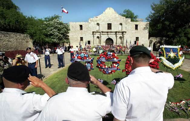 U.S. Army personel salute after laying a wreath at The Alamo during the 87th Annual Pilgrimage to The Alamo, Monday, April 23, 2012. Bob Owen/San Antonio Express-News. Photo: BOB OWEN, San Antonio Express-News / © 2012 San Antonio Express-News