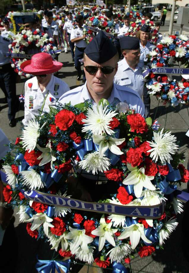 Chief MSgt Jim Cody of Randolph AFB carries a wreath to be laid at The Alamo during the 87th Annual Pilgrimage to The Alamo, Monday, April 23, 2012. Photo: BOB OWEN, San Antonio Express-News / © 2012 San Antonio Express-News