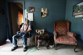 Paul Neace, 72, sits in his home in Owsley County on April 20, 2012 in Booneville, Kentucky. Daniel Boone once camped in the Appalachian mountain hamlet of Owsley County which remains mostly populated by descendants of settlers to this day. The 2010 U.S. Census listed Owsley County as having the lowest median household income in the country outside of Puerto Rico, with 41.5% of residents living below the poverty line.  Familial and community bonds run deep, with a populace that shares a collective historical and cultural legacy uncommon in most parts of the country.