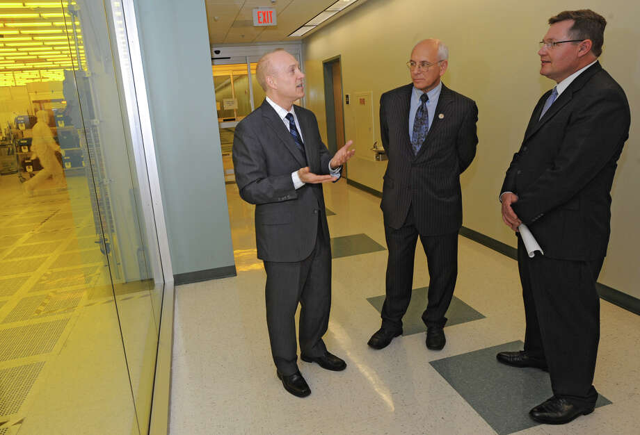 From left, Michael Fancher, CNSE Vice President for Business Development and Economic Outreach; Director, New York State Center for Advanced Technology in Nanomaterials and Nanoelectronics (CATN2); Associate Professor of Nanoeconomics, Congressman Paul Tonko and Mike Molnar, of NIST, tour the tour CNSE's Albany NanoTech Complex Monday April 23, 2012 in Albany, N.Y.  (Lori Van Buren / Times Union) Photo: Lori Van Buren