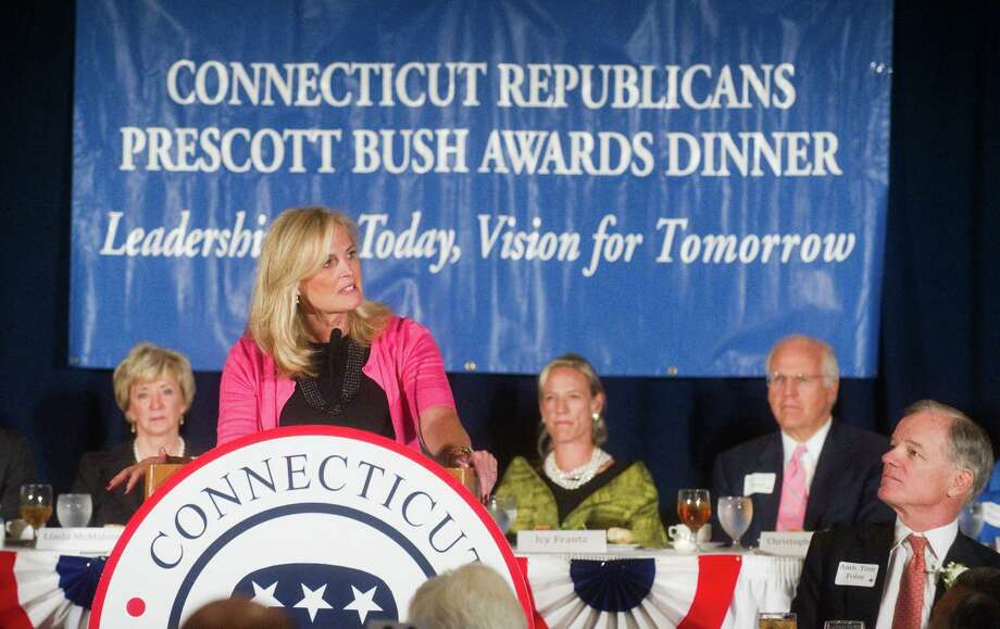 Ann Romney, wife of presumptive GOP presidential nominee Mitt Romney, keynotes the Prescott Bush Award dinner at the Stamford Marriott Hotel & Spa in Stamford, Conn., April 23, 2012. Senate hopeful Linda McMahon, left, Icy Frantz, Senate hopeful Chris Shays and former Republican gubernatorial candidate Tom Foley listen to Romney during the event, which is the biggest fundraiser of the year for the state GOP. Foley received the the Bush award and state Rep. Lile Gibbons, R-150th District, also received an award during the ceremony. Photo: Keelin Daly / Stamford Advocate