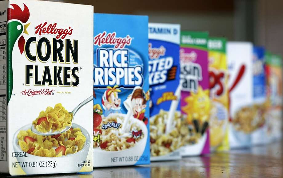 FILE - This Wednesday, Feb. 1, 2012 file photo, shows Kellogg's cereal products, in Orlando, Fla.  Cereal maker Kellogg Co. Kellogg Co. on Monday, April 23, 2012 cut its 2012 forecast because of slower sales growth in its first quarter. Its stock slid $3.14, or 5.8 percent, to $50.85 in premarket trading. Kellogg said that it now expects a full-year profit between $3.18 and $3.30 per share because of the weaker sales growth in Europe and for some U.S. products in the first three months of the year.  (AP Photo/John Raoux, File) Photo: John Raoux, Associated Press