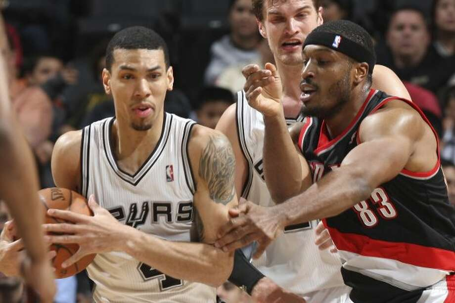 The Spurs'  Danny Green steal the ball away from Portland Trail Blazers Craig Smith during the first half at the AT&T Center, Monday, April 23, 2012. Jerry Lara/San Antonio Express-News (Jerry Lara / San Antonio Express-News)