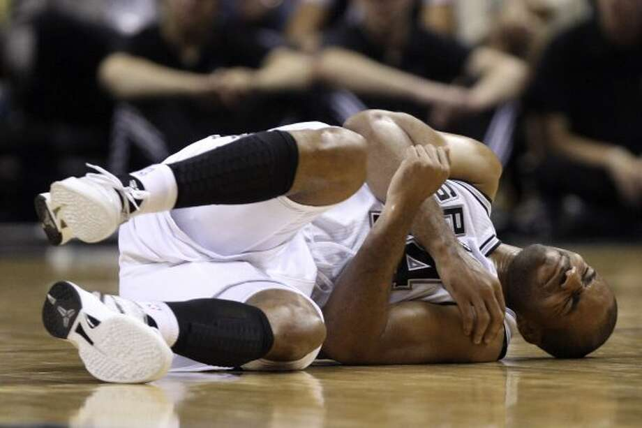 The Spurs'  Gary Neal lies on the floor after getting hurt in the second half against the Portland Trail Blazers at the AT&T Center, Monday, April 23, 2012. The Spurs won 124-89 and clinch the Western Conference number one spot. Jerry Lara/San Antonio Express-News (Jerry Lara / San Antonio Express-News)