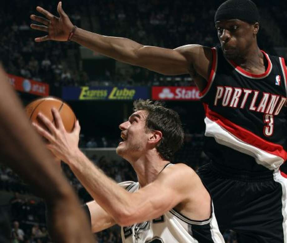 The Spurs'  Tiago Splitter gets pressure from Portland Trail Blazers  Johnny Flynn during the first half at the AT&T Center, Monday, April 23, 2012. Jerry Lara/San Antonio Express-News (Jerry Lara / San Antonio Express-News)