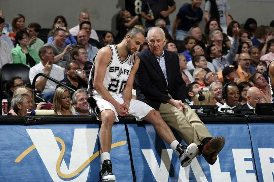 Spurs coach Gregg Popovich talks with Manu Ginobili during a break in their game against the Portland Trail Blazer at the AT&T Center, Monday, April 23, 2012. Jerry Lara/San Antonio Express-News (Jerry Lara / San Antonio Express-News)