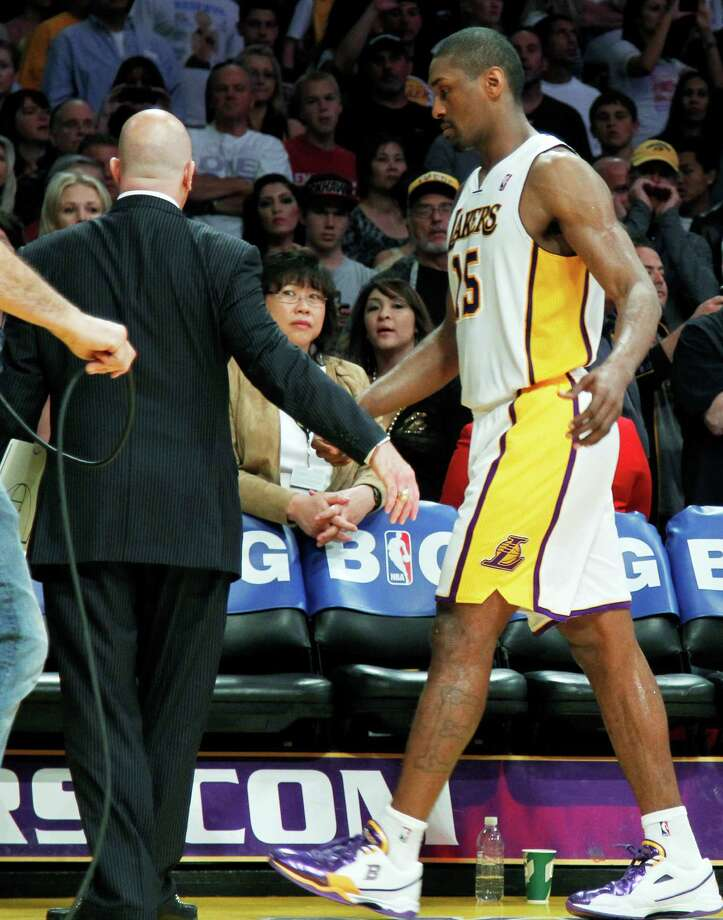 Los Angeles Lakers trainer Gary Vitti, left, escorts Metta World Peace from the court after he was ejected for double flagrant fouls against the Oklahoma City Thunder in the first half of an NBA basketball game in Los Angeles, Sunday, April 22, 2012. The Lakers won in double overtime, 114-106. Photo: AP