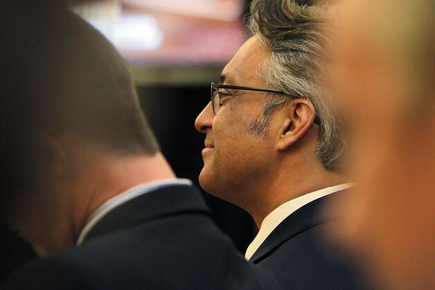 Sheriff Ross Mirkarimi, center, smiles as he listens to the San Francisco  Ethics Commission discussing the procedures it will follow for the sheriff's official misconduct hearing on Monday, April 23, 2012, in San Francisco, Calif. Photo: Carlos Avila Gonzalez, The Chronicle