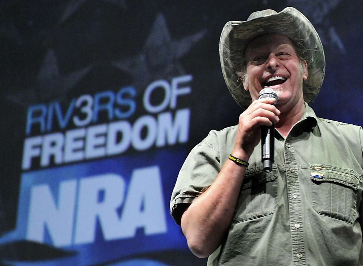"""FILE - In this May 1, 2011 file photo, musician and gun rights activist Ted Nugent addresses a seminar at the National Rifle Association's convention in Pittsburgh. Nugent says he will meet with the Secret Service on Thursday to explain his raucous remarks about what he called Barack Obama's """"evil, America-hating administration"""" _ comments that some critics interpreted as a threat against the president. (AP Photo/Gene J. Puskar, File)"""