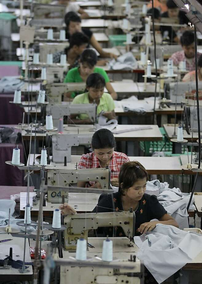 In this photo taken Saturday, April 21, 2012, young workers use sewing machines at a garment factory in Yangon, Myanmar. On Monday, April 23, 2012, the European Union confirmed it was suspending most of its sanctions against Myanmar to reward the country's recent wave of political reform. The suspension of trade sanction could help revive the nation's industries, restoring some of the 80,000 garment industry jobs lost here over the past 10 years. (AP Photo/Sakchai Lalit) Photo: Sakchai Lalit, Associated Press