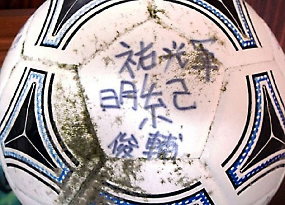 """This handout picture taken by the National Oceanic and Atmospheric Administration (NOAA) of the US and received via Jiji Press in Tokyo on April 23, 2012 shows a football which was found in Alaska and drifted from Japan's Rikuzentakata following the March, 2011 tsunami. Misaki Murakami, 16, lost his house and all its contents when the massive waves of last March crushed his hometown of Rikuzentakata in Japan's northeast. But now, thanks to an observant beachcomber in the Gulf of Alaska, he is set to have his football returned to him. The US National Oceanic and Atmospheric Administration (NOAA) said an observant beachcomber, identified by Japanese media as 51-year-old David Baxter, had spotted the ball on a beach on Middleton Island, Alaska. TOPSHOTS JAPAN OUT AFP PHOTO / NOAA via JIJI PRESS ---EDITORS NOTE--- RESTRICTED TO EDITORIAL USE - MANDATORY CREDIT """"AFP PHOTO / NOAA VIA JIJI PRESS"""" - NO MARKETING NO ADVERTISING CAMPAIGNS - DISTRIBUTED AS A SERVICE TO CLIENTS (Photo credit should read JIJI PRESS/AFP/Getty Images)"""