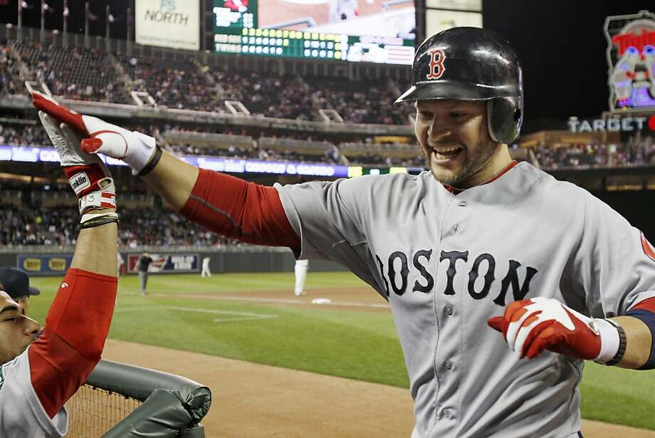 Boston Red Sox' Cody Ross celebrates his two-run, game-tying home run off Minnesota Twins pitcher Jason Marquis in the seventh inning of a baseball game Monday, April 23, 2012, in Minneapolis. (AP Photo/Jim Mone) Photo: Jim Mone, Associated Press