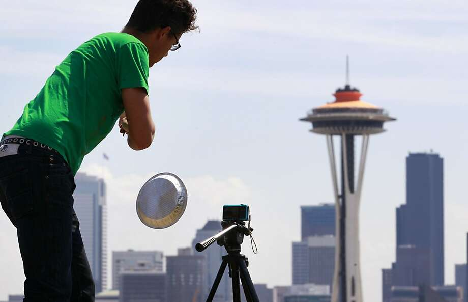 Traeden Mathews shoots a scene for a space-invaders film near the Space Needle in Seattle last year. Photo: Elaine Thompson, Associated Press