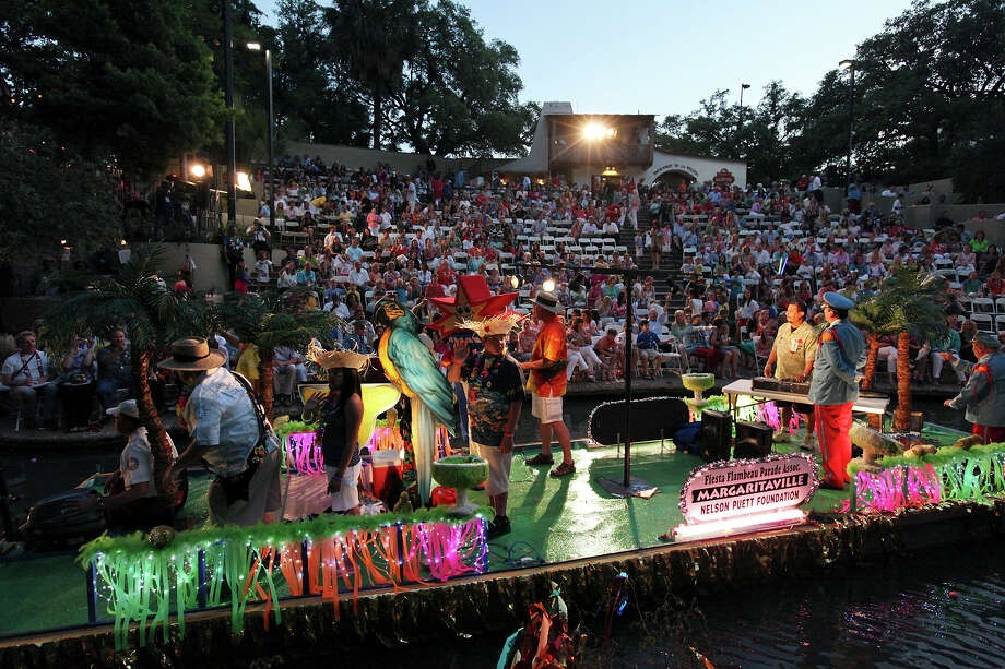 "The Fiesta Flambeau's ""Margaritaville"" float passes through the Arneson River Theatre during the 2012 Texas Cavaliers' River Parade ""Rockin' on the River"" on Monday, April 23, 2012. Photo: EDWARD A. ORNELAS, San Antonio Express-News / SAN ANTONIO EXPRESS-NEWS (NFS)"