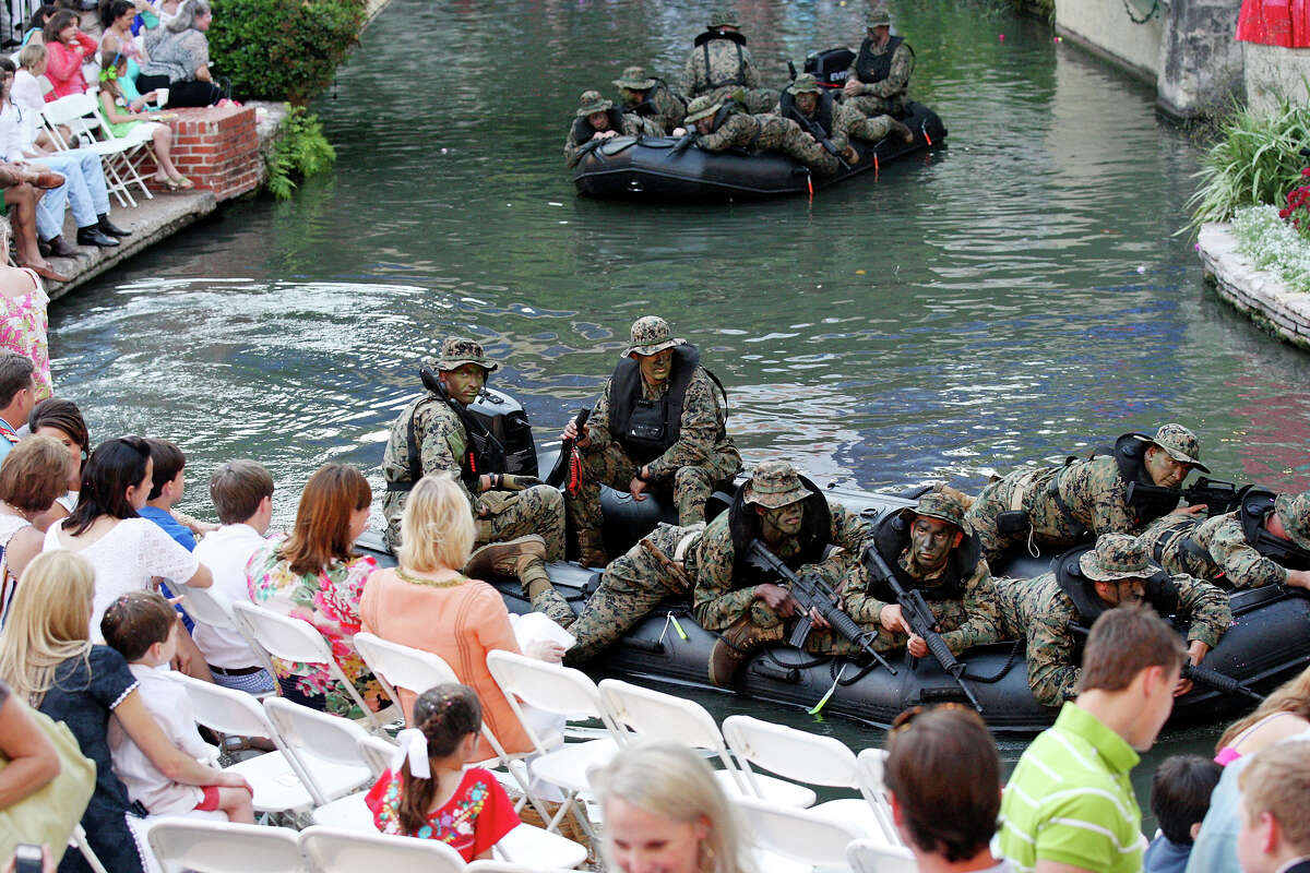 Members of the 4th Reconnaissance Battalion pass through the Arneson River Theatre during the 2012 Texas Cavaliers' River Parade