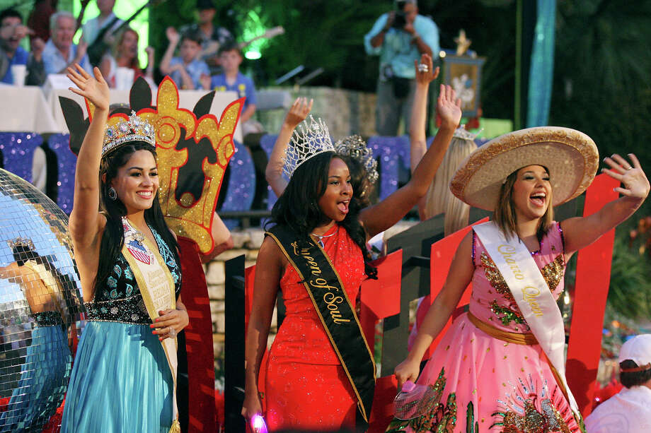 "2012 Reina de la Feria de las Flores Alanna Sarabia (from left), 2012 Queen of Soul Selena Mitchell, and 2012 Charro Queen Kellie Ramos wave to spectators while on the Fiesta S.A. Commission-Fiesta Royalty's ""Dancing Queen"" float during the 2012 Texas Cavaliers' River Parade ""Rockin' on the River"" on Monday, April 23, 2012. Photo: EDWARD A. ORNELAS, San Antonio Express-News / SAN ANTONIO EXPRESS-NEWS (NFS)"