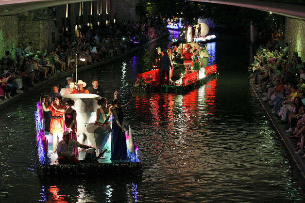 "Floats passes under Alamo Street during the 2012 Texas Cavaliers' River Parade ""Rockin' on the River"" on Monday, April 23, 2012. Photo: EDWARD A. ORNELAS, San Antonio Express-News / SAN ANTONIO EXPRESS-NEWS (NFS)"