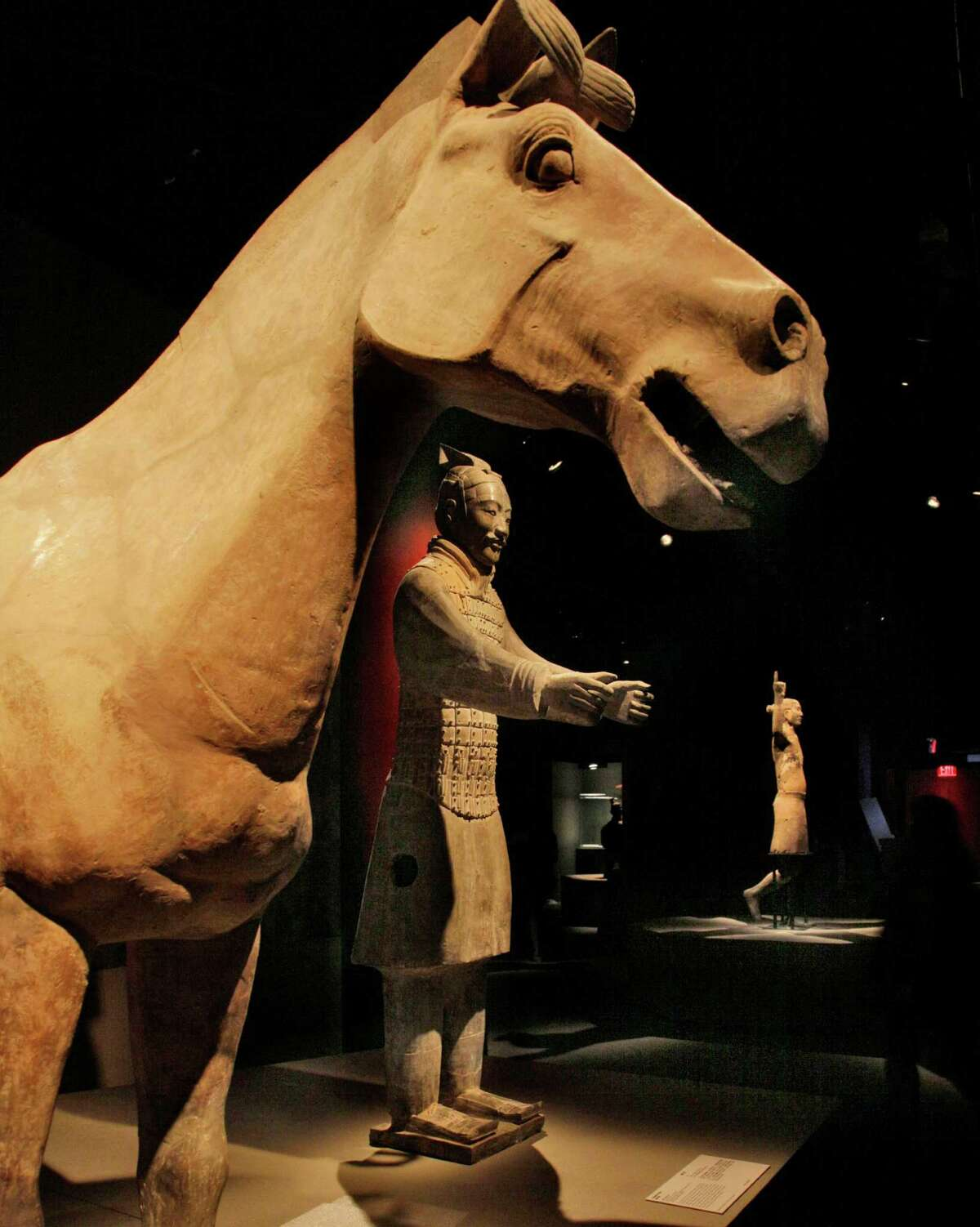 A horse, a charioteer and an acrobat from the