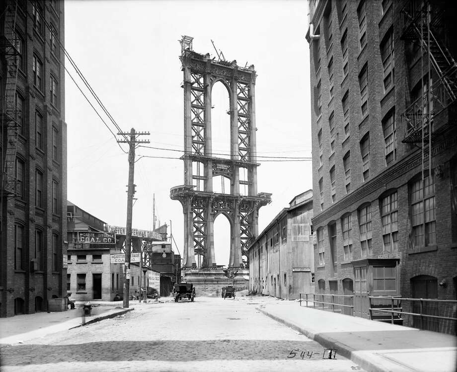 In this June 5, 1908 photo provided by the New York City Municipal Archives, the superstructure from the Manhattan Bridge rises above Washington Street in New York. Over 870,000 photos from an archive that exceeds 2.2 million images have been scanned and made available online, for the first time giving a global audience a view of a rich collection that documents life in New York City.  (AP Photo/New York City Municipal Archives, Department of Bridges/Plant & Structures, Eugene de Salignac) MANDATORY CREDIT Photo: Eugene De Salignac, AP / New York City Municipal Archives
