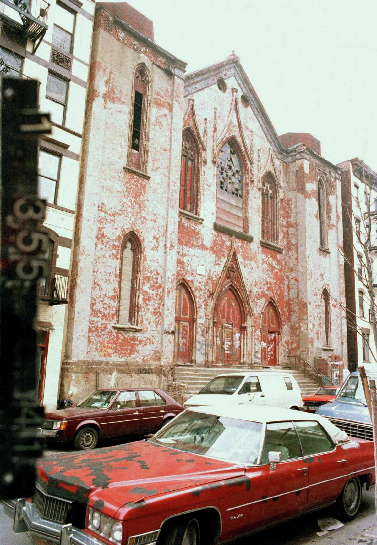 This circa 1983-1988 photo provided by the New York City Municipal Archives shows 172 Norfolk Street, which is now the Angel Orensanz Foundation, in New York. Over 800,000 color photographs were taken with 35-mm cameras for tax purposes. Every New York City building in the mid-1980s can be viewed in this collection. Over 870,000 photos from an archive that exceeds 2.2 million images have been scanned and made available online, for the first time giving a global audience a view of a rich collection that documents life in New York City.