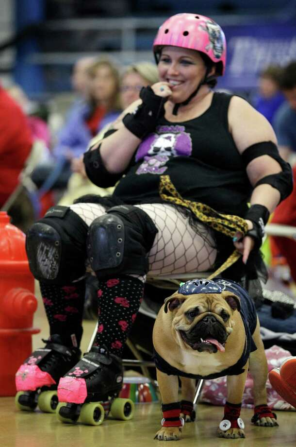 Leanne Sergio, of Ankeny, Iowa, sits with her dog Mya during the 33rd annual Drake Relays Beautiful Bulldog Contest Monday, April 23, 2012, in Des Moines, Iowa. The pageant kicks off the Drake Relays festivities at Drake University where a bulldog is the mascot. Photo: Charlie Neibergall, AP / AP