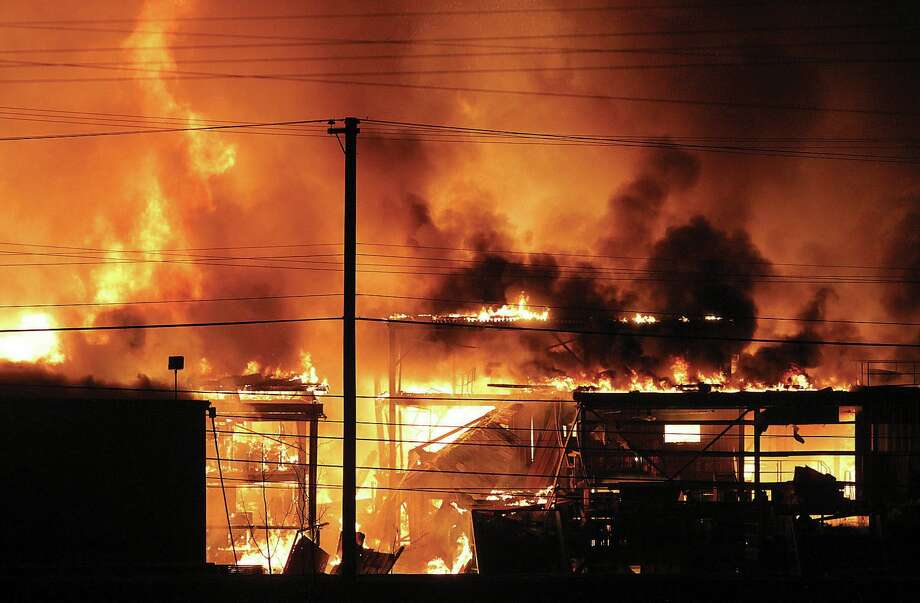 Forests have burned near Prince George, British Columbia, including this year's Shovel Lake fire.  Other conflagrations have hit northern British Columbia's largest city, including a huge sawmill fire pictured here. Photo: AP