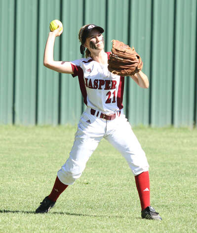 Kayle Dickerson fires a ball back into the infield. Photo: Jason Dunn