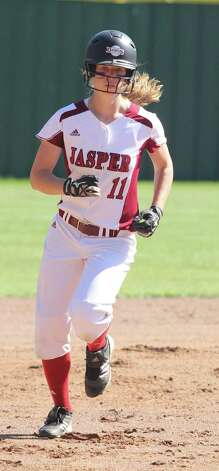 Hannah Boyett trots around the bases after delivering a homerun. Photo: Jason Dunn