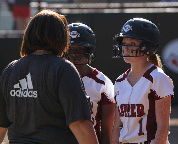 All eyes are Jasper Head Softball Coach Val Weldon as she intructs Shawneece Jones, center, and Cassidy Clark. Photo: Jason Dunn