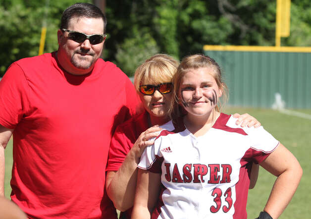 Senior Lacy Dry and her parents. Photo: Jason Dunn