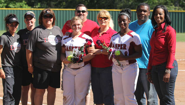 Jasper seniors Lacy Dry and Markeyia Armstrong were honored at the final district home contest. They are pictured with their parents and coaches, far left, Maritza Martinez, Meagan Weldon and Head Coach Val Weldon. Photo: Jason Dunn