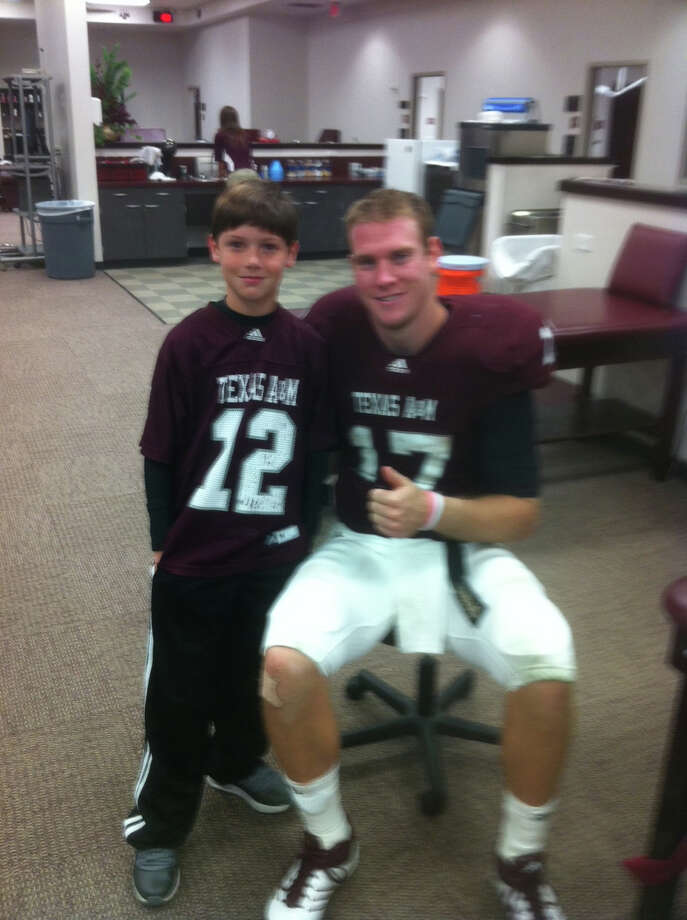 Ryan Tannehill met with 10-year-old Chalon Pratt just after the Oct. 29 loss to Missouri. Chalon's father died three weeks prior. Photo: Courtesy Photo
