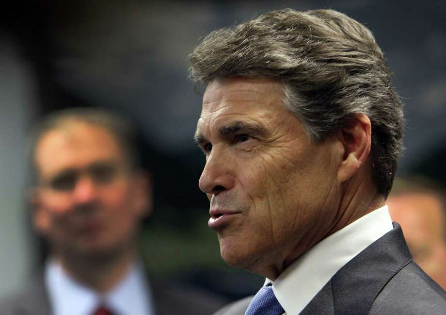 Last summer, Gov. Rick Perry's staff helped push through  legislation creating a stem cell bank. Now,  new rules for the use of stem cells could pose a risk for patients. Photo: James Nielsen, Houston Chronicle / © 2012 Houston Chronicle