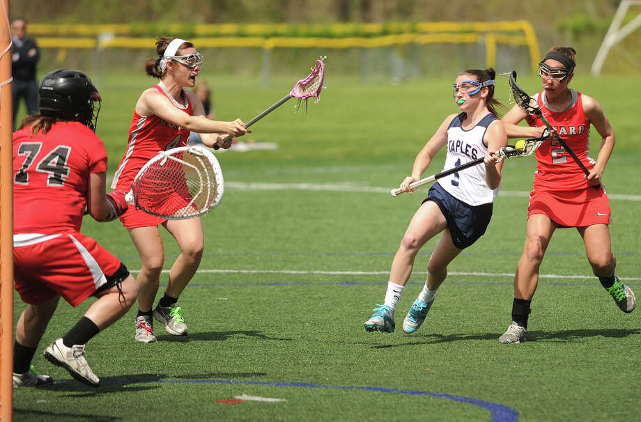 Staples' Paige Murray, white uniform, controls the ball against Conard last Wednesday. Murray had six goals Friday in a 15-12 home win over Trumbull. Photo: Brian A. Pounds, Brian A. Pounds/Staff Photographer / Connecticut Post