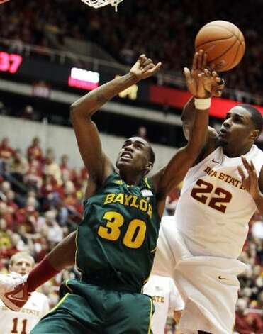 Iowa State forward Anthony Booker (22) blocks a shot by Baylor forward Quincy Miller (30) during the first half of an NCAA college basketball game, Saturday, March 3, 2012, in Ames, Iowa. (AP Photo/Charlie Neibergall) (AP)