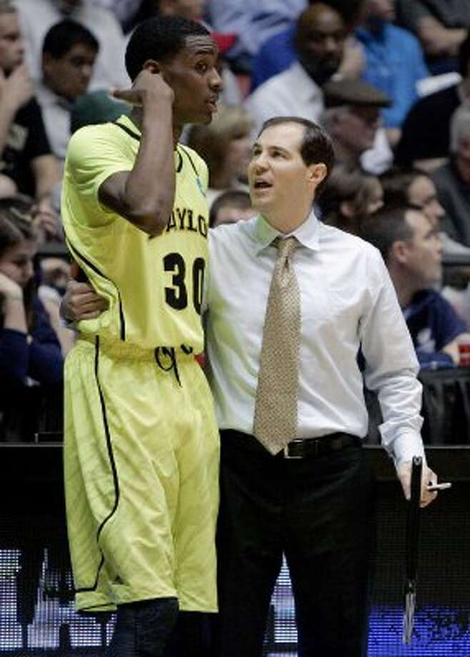In this March 17, 2012 file photo, Baylor coach Scott Drew, right, talks with forward Quincy Miller during the first half of an NCAA tournament third-round college basketball game against Colorado in Albuquerque, N.M. Baylor is experiencing great things these days. Only a few months after Robert Griffin III became Baylor's first Heisman Trophy winner, the men's basketball team is in the NCAA round of 16 for the second time in three years. And the top-ranked Lady Bears are undefeated, four wins from a national championship and the first 40-win season in the long history of the NCAA. (AP Photo/Jake Schoellkopf, File) (AP)