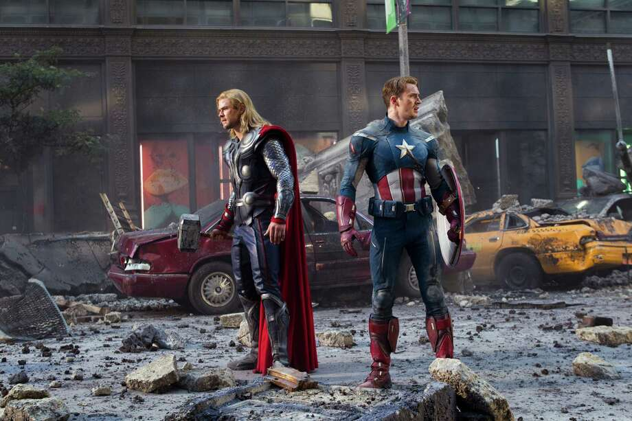 "In this film image released by Disney, Thor portrayed by Chris Hemsworth, left, and Captain America, portrayed by Chris Evans, are shown in a scene from ""The Avengers"" Photo: AP"