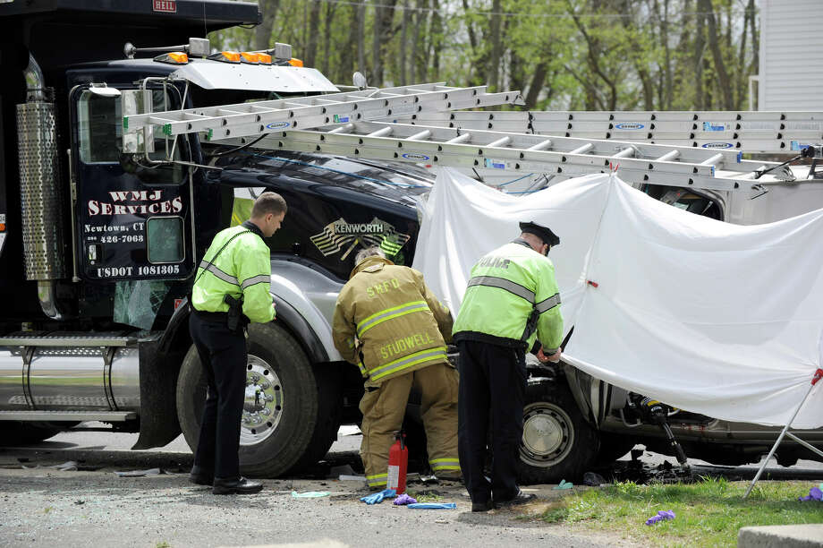 Police and firefighters respond the morning of Tuesday, April 24, 2012 to the scene of a fatal accident on Stony Hill Road in Bethel, Conn. in which a van and a dump truck collided. Photo: Carol Kaliff