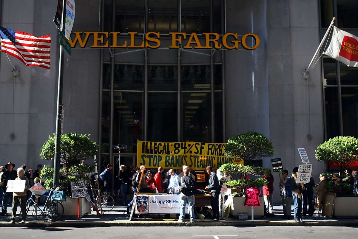 Occupy demonstrators protest in front of the Wells Fargo Bank at California and Montgomery Streets Monday, April 23, 2012 in San Francisco, Calif.