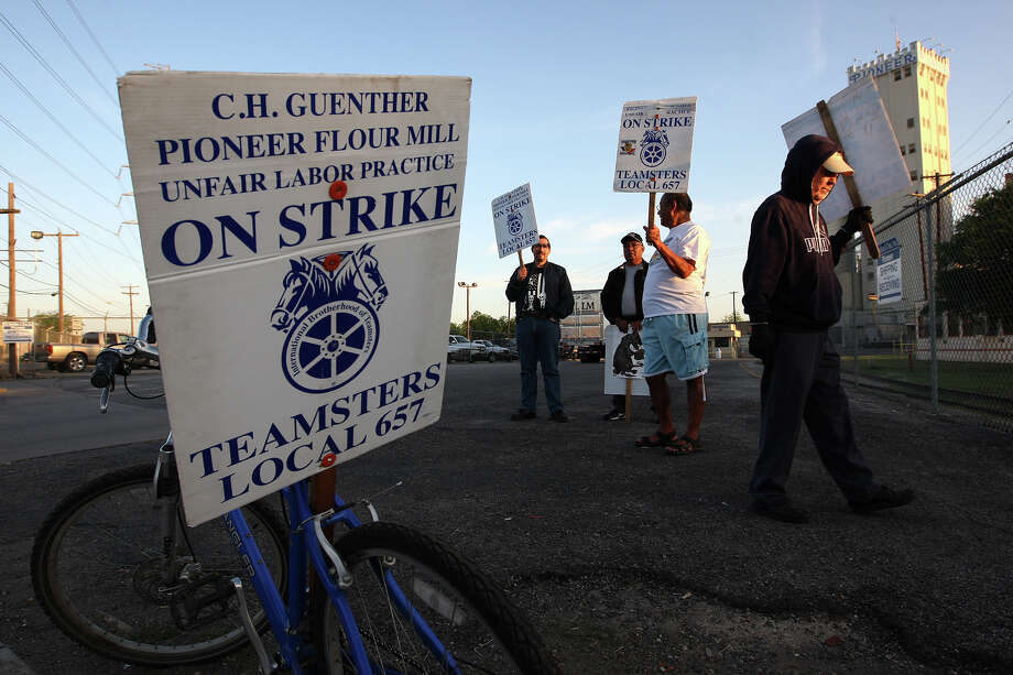 Striking employees gather near the entrance of C.H. Guenther & Son mill near South Alamo and Probandt streets. Photo: JERRY LARA, San Antonio Express-News / © 2012 San Antonio Express-News