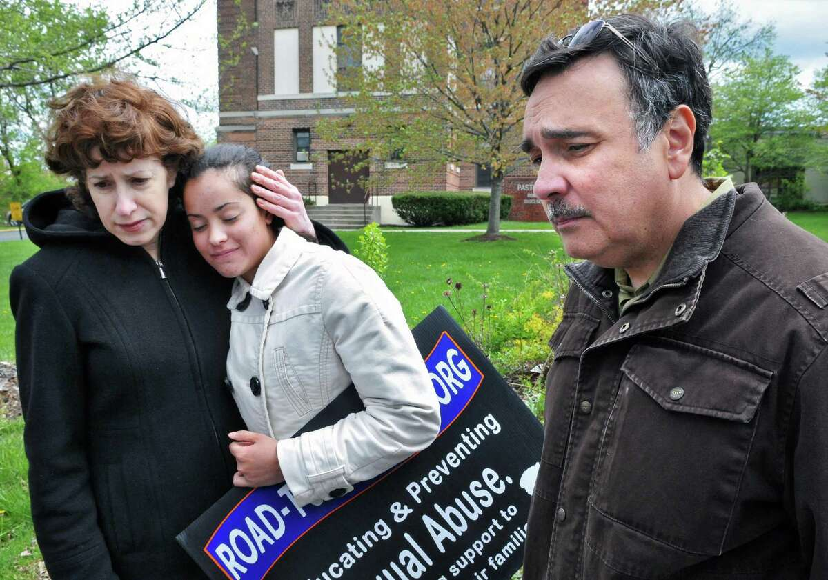 The family of alleged sexual abuse victims Martin Morales and his brother Ivan Morales Jr., from left, mother, Carole Morales, sister, Maria Morales and father, Ivan Morales Sr. during a news conference outside the Albany Diocesan headquarters in Albany Tuesday April 24, 2012. (John Carl D'Annibale / Times Union)
