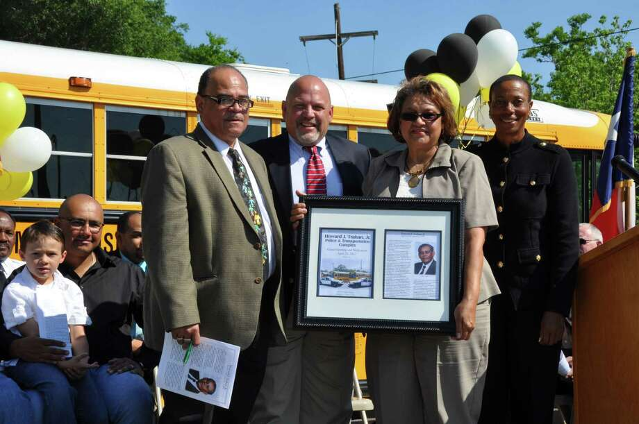 Loyce Trahan, wife of the late Howard J. Trahan, is presented a plaque in honor of the new Transportation Facility and Police Complex dedicated in his honor on April 24. Photo provided by BISD. Photo: Courtesy