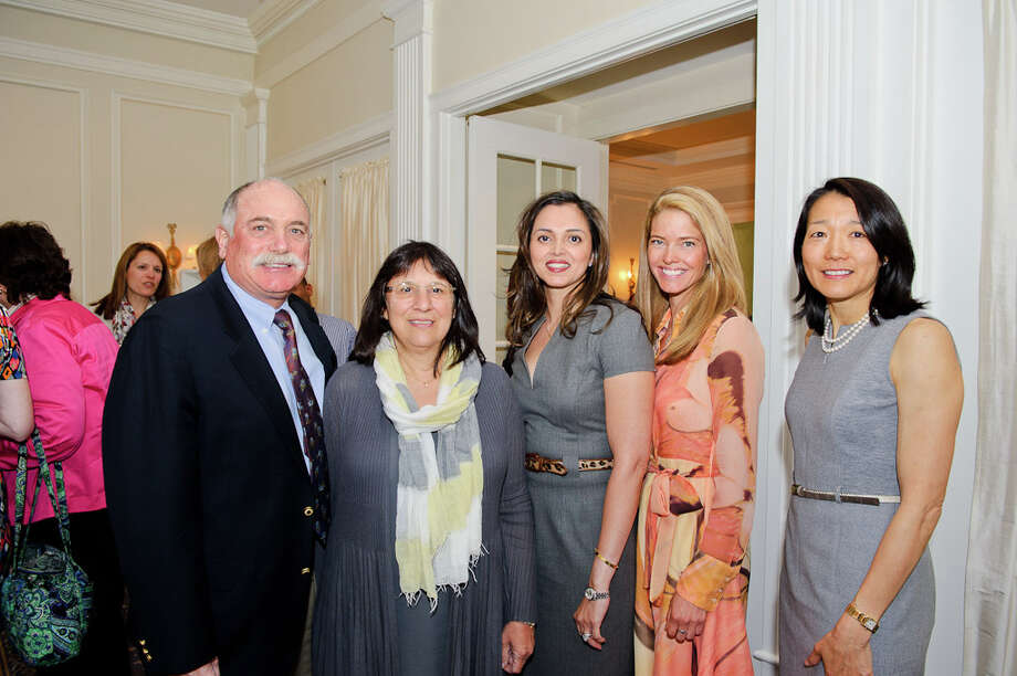 At left, Gary and Barbara Bloom, owners and directors of Camp Playland and Playland Nursery School in New Canaan, were honored with the 2012 Food Allergy Initiative of CT Leadership Award at a luncheon held March 27. Also pictured are Saira Rizvi, luncheon co-chairman and New Canaan resident; Jennifer Ferm, luncheon co-chairman and Rowayton resident; and Helen Jaffe FAI of CT chairman and New Canaan resident. Photo courtesy of Manish Gosalia Photo: Contributed Photo